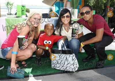 Romeo Miller Photo - Amber Meade (L) guest Sarah Michaels and singer Romeo Miller (aka Lil Romeo) pose at Melanie Segals VMA gifting party held at West Hollywoods SLS Hotel in celebration of the 2010 MTV Video Music Award show which will be held tomorrow Los Angeles CA 091110
