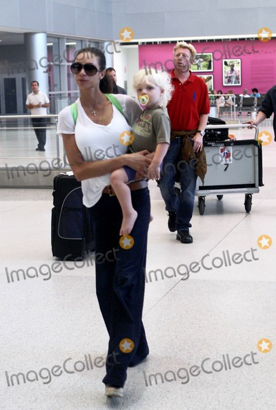 Adored Photo - Boris Becker makes his way through Miami International Airport with his adorable blonde son Amadeus now 18 months old and his wife Sharlely The family are in town to help celebrate Elias Beckers 12th birthday tomorrow Boris who is also planning a trip to New York for the US open appeared to be limping as the family strolled through the terminal Miami FL September 3rd 2011  Local Caption   Sharlely Lilly Kerssenberg