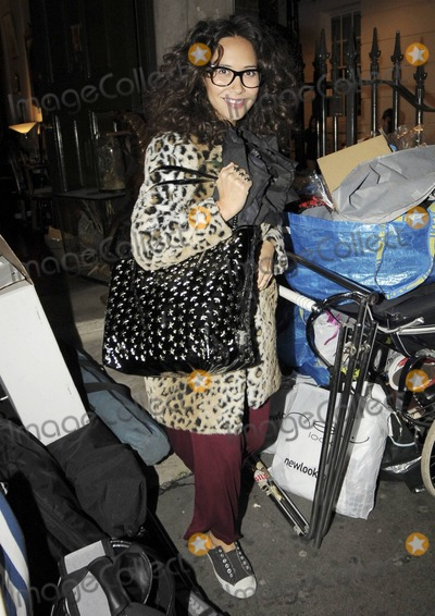 HearSay Photo - EXCLUSIVE Pregnant pop singer pianist and TV personality Myleene Klass looks happy and comfy as she leaves a photo shoot late in the evening in a mismatched outfit of a burgundy maxi dress baby-bump covering leopard patterned coat sparkly star tote bag nerd glasses scarf and Converse sneakers  The former HearSay singer posted to her Twitter account Fun shootHave been back combed to within an inch of my life And in a later posted Um anyone got any conditioner London UK 100710 Fees must be agreed prior to publication