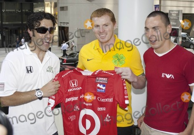 Neil Lennon Photo - Scottish race car driver Dario Franchitti who is married to actress Ashley Judd chats and poses with Scottish footballer Scott Brown of the Celtics and Celtic manager Neil Lennon during a photo op at the Duke of Devon pub in Toronto  The trio spoke with reporters and exchanged a jersey as Franchitti is a Celtics fan  Franchitti is in town for the 2010 Honda Indy Toronto taking place July 16-18 and the Celtics are gearing up for their overseas match with Manchester United tomorrow at Torontos Rogers Centre Pictured (L-R) Dario Franchitti Neil Lennon Scott Brown Toronto ON 071510