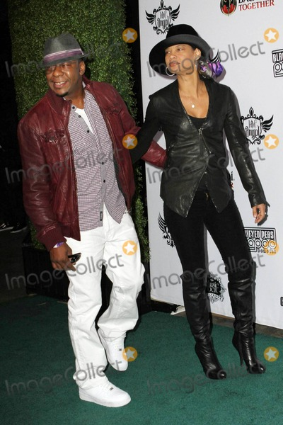 Alicia Etheridge Photo - Bobby Brown and girlfriend Alicia Etheridge arrive at the seventh annual Black Eyed Peas Peapod Benefit Concert held at the Music Box Theatre Los Angeles CA 021011
