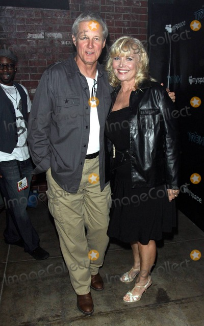Bruce Boxleitner Photo - Bruce Boxleitner and Cindy Morgan arrive at the San Diego Convention Center for Disneys TRON Legacy party hosted by MySpace during Comic-Con 2010  The party dubbed Comi-Tron was held inside a recreation of Flynns Arcade from the film and showcased a new trailer and 3D footage of the sci-fi sequel  TRON Legacy director Joseph Kosinski has been quoted as saying Comic-cons kind of a comfortable place for us to be because thats where we showed up two years ago with that little VFX demo we did testing the waters and seeing if anyone was interested in this movie at all In fact I think the response we got from that showing two years ago is kind of a big reason Im still here today working on this thing  San Diego CA 072310
