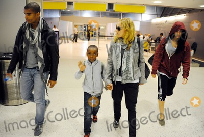 JFK Photo - EXCLUSIVE Madonna her new boyfriend Brahim Zaibat and her children Mercy David and Lourdes arrive at JFK International Airport as they head overseas for a family celebration of Madges 53rd birthday tomorrow New York NY 15th August 2011Fees must be agreed prior to publication