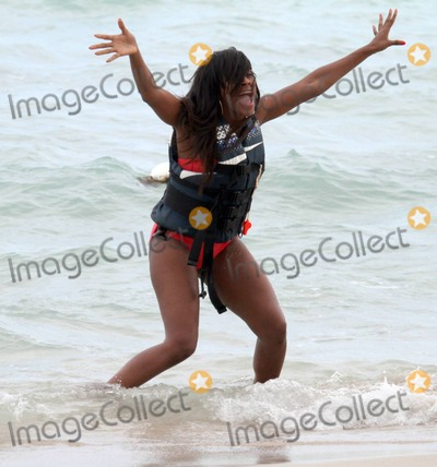 Willow Smith Photo - EXCLUSIVE Alexandra Burke whips her hair like Willow Smiths infamous song during a day at the beach with friends Vanessa White and Cartier Fraser Burke broke into an excited dance as she hit the water before jumping on a jet ski with Vanessa who is in the UK girl band The Saturdays Miami Beach FL 3611Fees must be agreed prior to publication