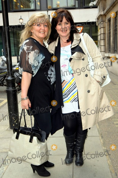 Linda Nolan Photo - Coleen and Linda Nolan of The Nolans an Irish all-female band consisting of a group of sisters and best-known for their song Im In the Mood for Dancing are all smiles as they pose for photos at BBC Radio 2 London UK 41811