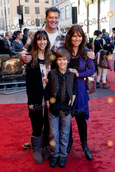Sam Neill Photo - Linda Lusardi husband Sam Kane and their children pose for photographers on the red carpet at the UK premiere of Warner Bros Legend of the Guardians The Owls of GaHoole held at Odeon cinema in Londons West End  The adventure and fantasy animation directed by Zack Snyder (Watchmen 300) features the voices of Helen Mirren Sam Neill Jim Sturgess and Geoffrey Rush  Based on a popular book series the family film has been described as a childrens version of Braveheart with reviews saying its a dark and dense tale filled with noble warriors mighty clashes and feathers flying London UK 101010