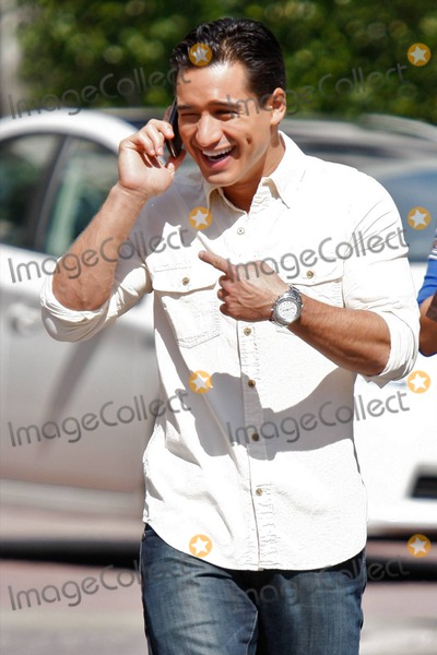 Olivia Newton-John Photo - New dad actor and TV personality Mario Lopez has a smile from ear to ear as he arrives at The Grove shopping center to work on the American TV show Extra where actress Olivia Newton-John and actor Chevy Chase were interviewed  Lopezs girlfriend Courtney Mazza gave birth to their first child daughter Gia Francesca Lopez on September 11th  Los Angeles CA 100710