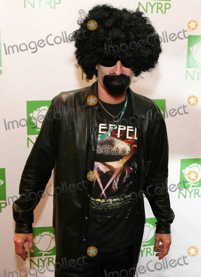 John McEnroe Photo - John Mcenroe arrives in costume at the 15th annual Bette Midlers New York Restoration Projects Hulaween Benefit Gala held at The Waldorf-Astoria Hotel New York NY 102910