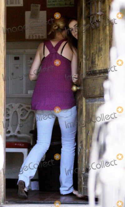 Ali Lohan Photo - Ali Lohan receives deliveries for sister Lindsay Lohan at the Pickford Lofts sober-living house Lindsays assistant was busy running errands during the day bringing in food and other items that included a case of Coca Cola and numerous bottles of water Other friends also left bags at the door during the day which Ali came outside to retrieve for Lilo Lindsay Lohan s due to report to jail by Tuesday and has been living in the facility since last Wednesday The Pickford Lofts was founded by famed defense attorney Robert Shapiro best known for defending OJ Simpson during his infamous trial Los Angeles CA 71810