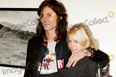 Nick Valensi Photo - Nick Valensi (the Strokes) and Amanda DE Cadenet Arriving at the Opening Reception For Anton Corbijns Exhibition  U2  I at the Stellan Holm Gallery in New York on 10-09-2005 Photo by Henry McgeeGlobe Photos Inc 2005