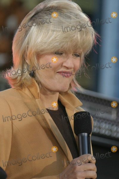 Andy Taylor Photo - NYC  101204Diane Sawyer (hair blowing in her face) introducing Bandmembers of DURAN DURAN Simon Le Bon Nick Rhodes John Taylor Andy Taylor and Roger Taylor before performing on Good Morning America in Times SquareDigital Photo by Adam Nemser-PHOTOlinkorg