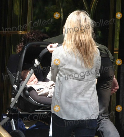 Aaron Johnson Photo - NYC  091410EXCLUSIVE Aaron Johnson (20 year old star of Kick-Ass) and fiance director Sam Taylor-Wood (43 years old) in town promoting their new movie Nowhere Boy that she directed and he stars in walking and videoing themselves in Central park with their 2 month old daugher Wylda Rae JohnsonEXCLUSIVE photo by Adam Nemser-PHOTOlinknet