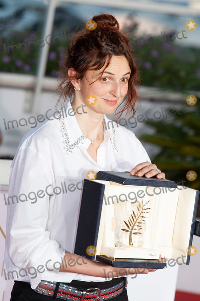 Alice Rohrwacher Photo - CANNES FRANCE - MAY 19 Italian director Alice Rohrwacher poses with her trophy on May 19 2018 during a photocall after she jointly won the Best Screenplay prize for the film Lazzaro Felice (Happy as Lazzaro) atl the Palme DOr Winner during the 71st annual Cannes Film Festival at Palais des Festivals on May 19 2018 in Cannes France (Photo by Laurent KoffelImageCollectcom)