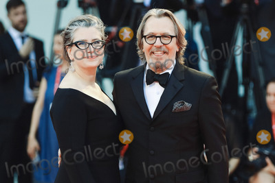 Gisele Photo - VENICE ITALY - SEPTEMBER 01 Gisele Schmidt and Gary Oldman walk the red carpet ahead of the The Laundromat screening during the 76th Venice Film Festival at Sala Grande on September 01 2019 in Venice Italy (Photo by Laurent KoffelImageCollectcom)