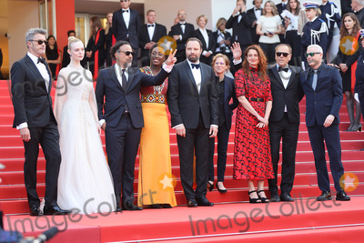 Bilal Photo - CANNES FRANCE - MAY 25 (L-R) Jury Members of the main competition Pawel Pawlikowski Elle Fanning Alejandro Gonzalez Inarritu Maimouna NDiaye Yorgos Lanthimos Kelly Reichardt Robin Campillo Alice Rohrwacher and Enki Bilal attend the closing ceremony screening of The Specials during the 72nd annual Cannes Film Festival on May 25 2019 in Cannes France(Photo by Laurent KoffelImageCollectcom)