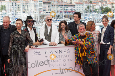 Adam Driver Photo - CANNES FRANCE - MAY 19 Director Terry Gilliam (front) poses with (L-R) Jordi Molla Stellan Skarsgard Olga Kurylenko Oscar Jaenada Jonathan Pryce Joana Ribeiro Adam Driver Alessandra Lo Savio Amy Gilliam and Sergi Lopez attend The Man Who Killed Don Quixote Photocall during the 71st annual Cannes Film Festival at Palais des Festivals on May 19 2018 in Cannes France(Photo by Laurent KoffelImageCollectcom)