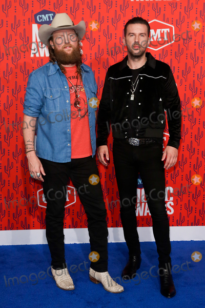 Brothers Osborne Photo - NASHVILLE - JUNE 5 John Osborne (L) and TJ Osborne of the Brothers Osborne attend the 2019 CMT Music Awards at the Bridgestone Arena on June 5 2019 in Nashville Tennessee