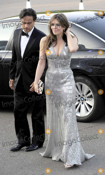Arun Nayer Photo - Arun Nayer and Elizabeth Hurley at The Caudwell Children Butterfly Ball on May 20 2010 in London