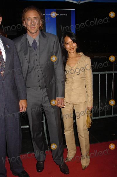 Alice Kim Photo - Nicholas Cage and Alice Kim attend the World Trade Center World Premiere held at the Ziegfeld Theatre