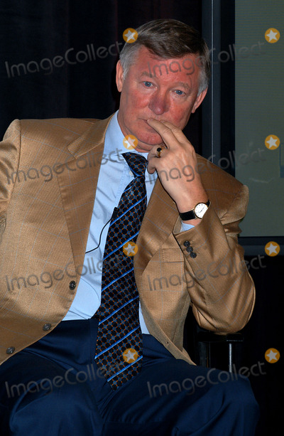 Alex Ferguson Photo - Manchester United coach Sir Alex Ferguson during a news session to announce that 2004 Champions World Series will take Manchester United to USA for three matches The worlds most famous soccer team will play at Soldier Field in Chicago and at Giants Stadium in New York area New York November 11 2003