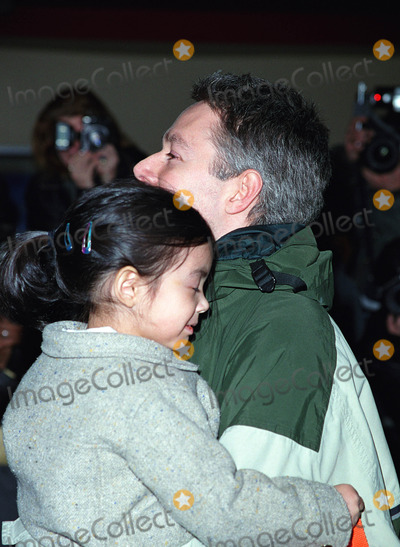 Adam Yauch Photo - ADAM YAUCH of Beastie Boys with his daughter attending the Amnesty Internationals 5th Annual Media Spotlight Awards at Chelsea Piers in New York January 28 2002  2002 by Alecsey BoldeskulNY Photo Press  ONE-TIME REPRODUCTION RIGHTS