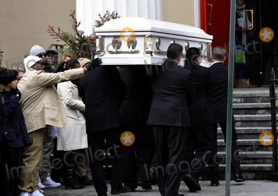 Avonte Oquendo Photo - January 25 2014 New York CityThe funeral of Avonte Oquendo took place at  the Church of Saint Joseph in Greenwich Village on January 25 2014 in New York CityIt was  led by the former Roman Catholic archbishop of New York Cardinal Edward Egan Avonte Oquendo who was autistic went missing from his Queens school in OctoberIn this picture his father reaches out to touch the coffin