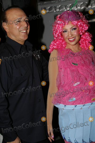 Thalia Mottola Photo - Music producer Tommy Mottola and his wife singer Thalia arrive in costume at Bette Midlers annual Hulaween Party on October 29 2010 in New York City