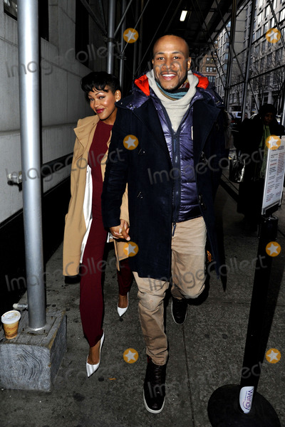 Meagan Good Photo - December 16 2013 New York CityActress Meagan Good and DeVon Franklin walk in Midtown Manhattan on December 16 2013 in New York City