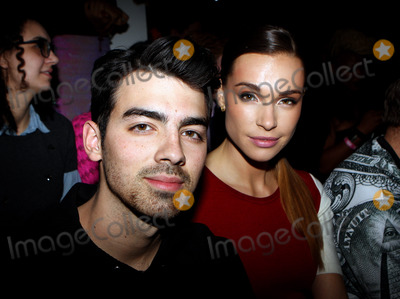 The Blonds Photo - February 12 2014 New York City(L-R) Joe Jonas and Blanda Eggenschwiler at the The Blonds fashion show during MADE Fashion Week Fall 2014 at Milk Studios on February 12 2014 in New York City
