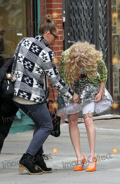 AnnaSohpia Robb Photo - April 1 2012 New York CityActress AnnaSophia Robb has her spanx underwear fiddled with a by a wardrobe person on the set of the new TV show The Carrie Diaries on April 1 2012 in New York City