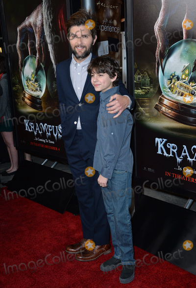Adam Scott Photo - Actors Adam Scott  Emjay Anthony at the Los Angeles premiere of their movie Krampus at the Arclight Theatre HollywoodNovember 30 2015  Los Angeles CAPicture Paul Smith  Featureflash
