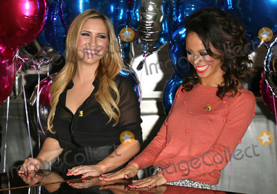 Heidi Range Photo - Sugababes Heidi Range and Amelle Berrabah celebrating the launch of BBC Children in Need POP Goes the Musical at Kensington Roof Gardens west London 31082011 Picture by Alexandra Glen  Featureflash