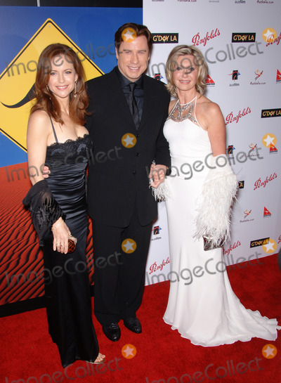 Olivia Newton-John Photo - Actor JOHN TRAVOLTA  wife actress KELLY PRESTON (left) with singeractress OLIVIA NEWTON-JOHN at the Penfolds Icon Gala Dinner part of the GDay LA Australia Week at the Hollywood PalladiumTravolta presented the Lifetime Achievement Award to Newton-JohnJanuary 14 2006  Los Angeles CA 2006 Paul Smith  Featureflash