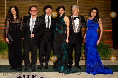 Adam Clayton Photo - Bono The Edge Adam Clayton and their wives arriving for the 2014 Vanity Fair Oscars Party Los Angeles 02032014 Picture by James McCauleyFeatureflash