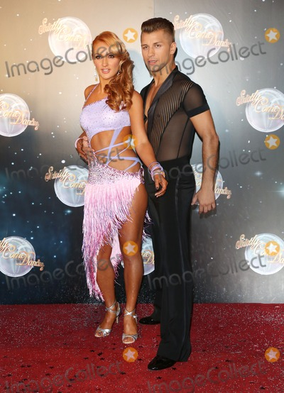 Aliona Vilani Photo - Aliona Vilani and Pasha Kovalev arriving for the Strictly Come Dancing 2012 Launch Television Centre London 11092012 Picture by Henry Harris  Featureflash