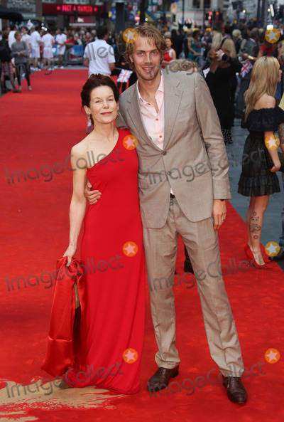 Alice Krige Photo - Alice Krige and Chris Tomlinson arriving for the Chariots of Fire Premiere held at the Empire Leicester Square - London England 10072012 Picture by Henry Harris  Featureflash