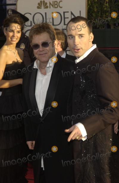 Elton John Photo - SIR ELTON JOHN (left)  partner DAVID FURNISH at the 61st Annual Golden Globe Awards at the Beverly Hilton Hotel Beverly Hills CAJanuary 25 2004