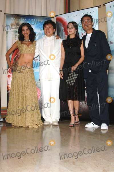 Tony Leung Ka Fai Photo - Actors JACKIE CHAN (in white)  TONY LEUNG KA FAI with Bollywood star MALLIKA SHERAWAT  Korean actress KIM HEE-SEON (in black) at the 58th Annual Film Festival de Cannes to promote their new movie The MythMay 17 2005 Cannes France 2005 Paul Smith  Featureflash