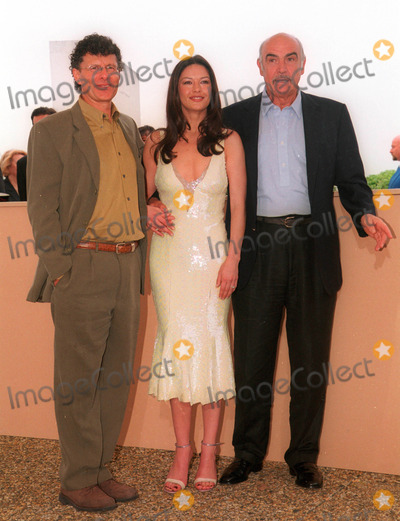 Amiel Photo - 14MAY99 Director JON AMIEL (left) with actor SEAN CONNERY  actress CATHERINE ZETA JONES at the Cannes Film Festival to promote their new movie Entrapment Paul Smith  Featureflash