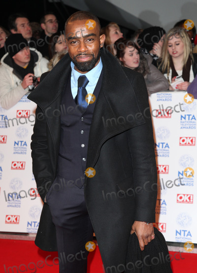 Wil Johnson Photo - Wil Johnson arriving for the National Television Awards 2013 at the O2 Arena London 23012013 Picture by Alexandra Glen  Featureflash
