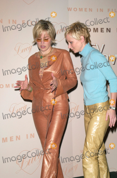 The Ceremonies Photo - Actress SHARON STONE  ANNE HECHE at the Women in Films Annual Lucy Awards luncheon in Beverly Hills Their TV movie If These Walls Could Talk 2 which was honored at the ceremony