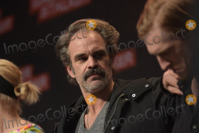 Austin Amelio Photo - MANNHEIM GERMANY - MARCH 17 (L to R) Actors Steven Ogg Austin Amelio (The Walking Dead) panel at Walker Stalker Germany convention (Photo by Markus Wissmann)