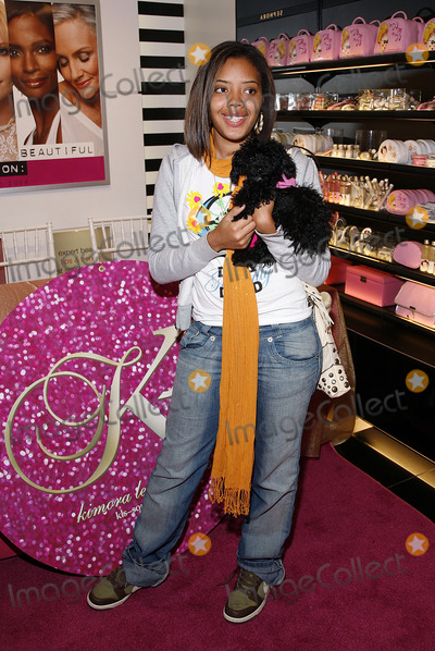 Angela Simmons Photo - Angela Simmons poses for pictures during the launch of her aunt Kimora Lee Simons KLS COSMETICS line at Sephora in Times Square on May 11 2006 in New York City
