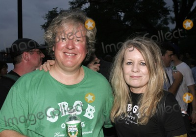 Tina Weymouth Photo - Talking Heads members Chris Franz (L) and Tina Weymouth pose for a picture during Steven Van Zandts Save CBGBs Rally in Washington Square Park August 31 2005 in
