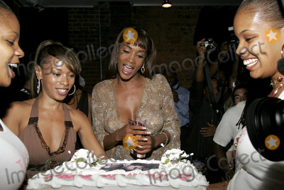 Alicia Fox Photo - Jolie magazine editor-in-chief Alicia Rivers (L) presents a cake to actress Vivica A Fox during the Jolie magazine launch party September 17 2005 in New York City