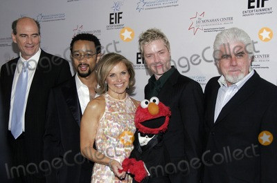 Taylor James Photo - (L-R) James Taylor John Legend Katie Couric Chris Botti and Michael McDonald pose for pictures during the Entertainment Industry Foundations NCCRA (EIFs NCCRA) colon cancer benefit at the Waldorf Astoria on March 15 2006 in
