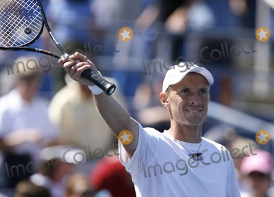 Nicolas Almagro Photo - Nikolay Davydenko of Russia thanks the crowd after his win against Nicolas Almagro of Spain during day six of the 2007 US Open at the Billie Jean King National Tennis Center on September 1 2007 in the Flushing neighborhood of the Queens borough of New York City