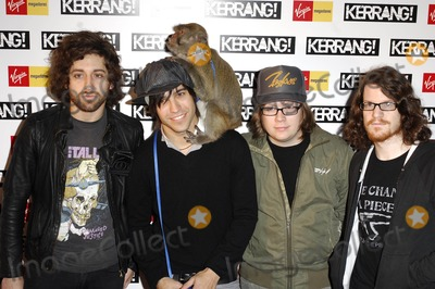 Andy Hurley Photo - London UK Joe Trohman Pete Wentz Patrick Stump and Andy Hurley of Fall Out Boy arrive at the Kerrang Awards held at Old Truman Brewery in London Although drummer Andy Hurley (4th R) is vegan and has done promotions for PETA Fall Out Boy has received criticism from animal rights groups for their use of chimpanzees an orangutan and a monkey in the music video of Thnks fr th Mmrs Despite objections from these groups Pete Wentz brought his chimpanzee to the Kerrang Awards 23rd August 2007Ali KadinskyLandmark Media