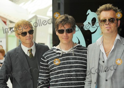 A-Ha Photo - London UK  Norwayss greatest ever pop export A-Ha (Morten Harket Paul Waaktaar-Savoy Magne Furuholmen) celebrate the release of their new album Foot Of The Mountain with a show at Westfield shopping centres first ever summer festival Shimmer 0928 July 2009Ref  Ali KadinskyLandmark Media