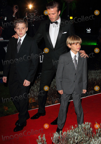Brooklyn Beckham Photo - London UK  David Beckham with sons Brooklyn (L) and Romeo (R) at the The Sun newspaper Military Awards (The Millies)   Imperial War Museum London  19th December 2011 Keith MayhewLandmark Media